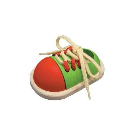 Ata el zapato, Plan Toys